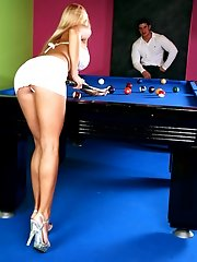 Blonde playing with balls and a stick for pleasure